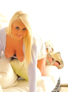 Busty blonde Alexis gets comfy